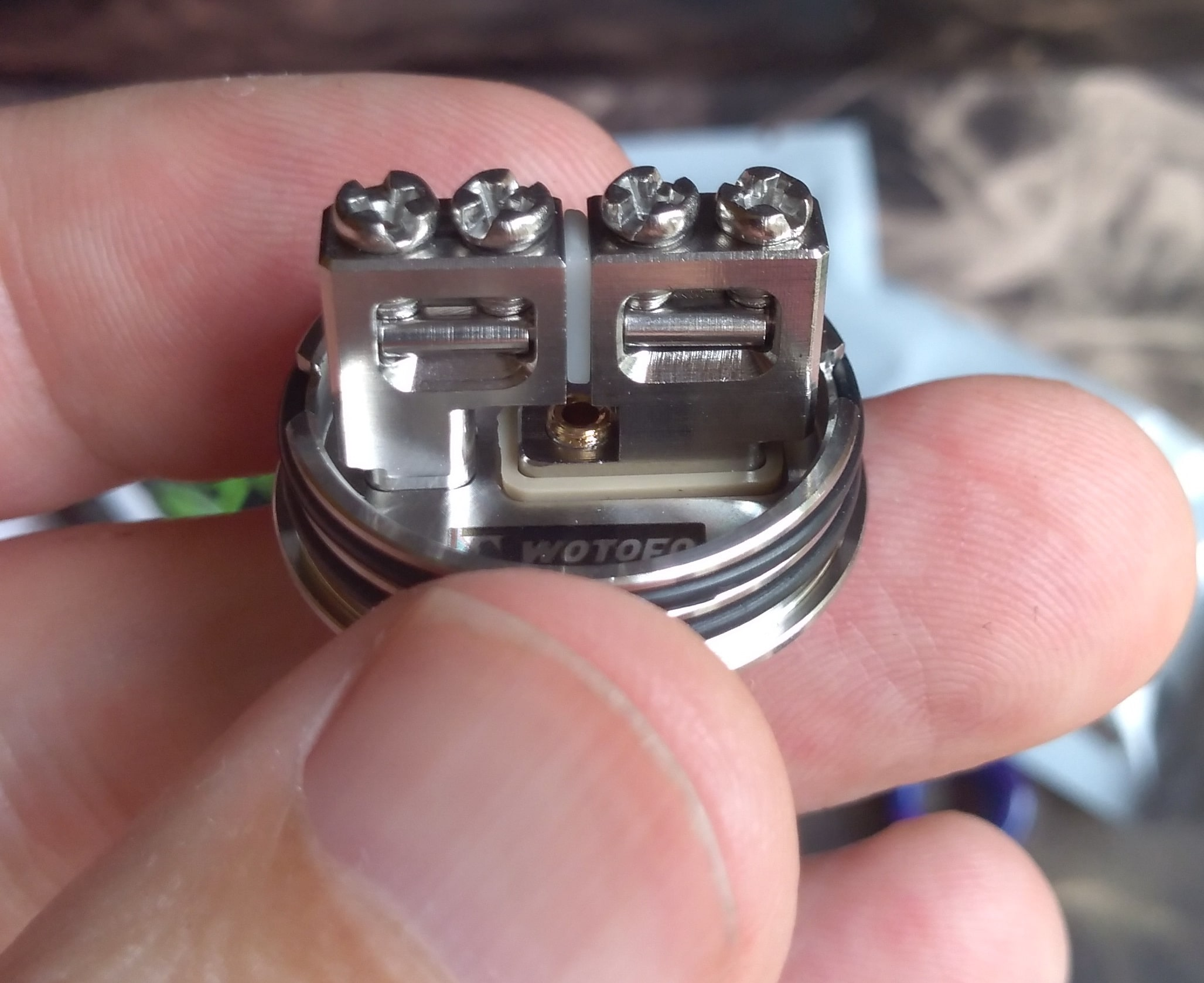 Wotofo Warrior BF RDA deck with a lot of coil building space and juice feeding hole